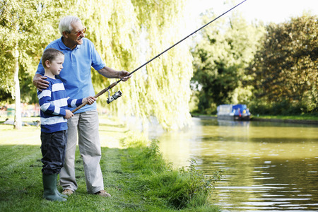 Grandfather and grandson fishing together photo