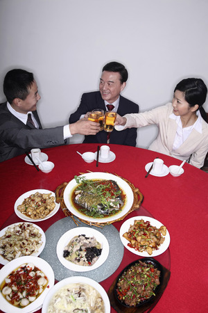 Business people eating together photo