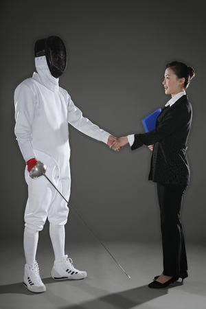 Man shaking hands with a businesswoman photo