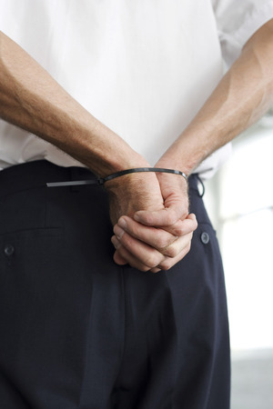 restraining device: Man with hands tied to the back