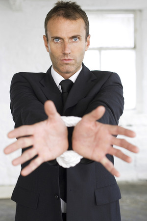 Businessman with his wrist tied up photo
