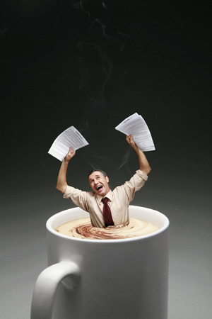 drowning: Businessman drowning in a cup of coffee