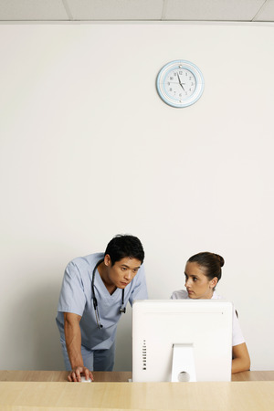 Doctor and nurse using computer photo