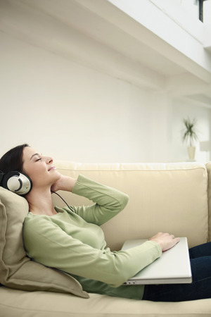 closes eyes: Woman listening to music with her eyes closed