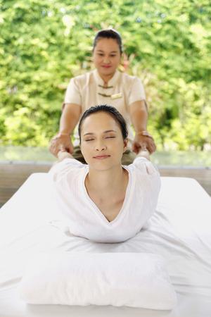 Woman enjoying a body massage Stock Photo