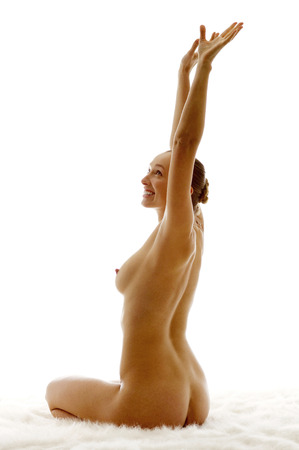 nude young woman: Nude young woman raising her hands