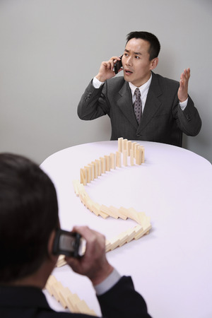 Businessmen talking on mobile phones photo