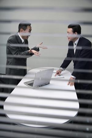 subordinate: Businessman asking his subordinate about some documents