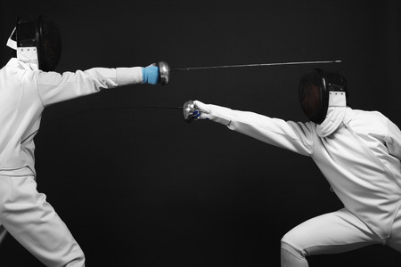 quarter foil: Man attacking his opponent Stock Photo