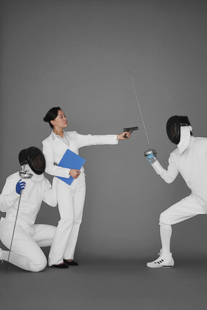 quarter foil: Businesswoman protecting a man by holding a gun at his opponent
