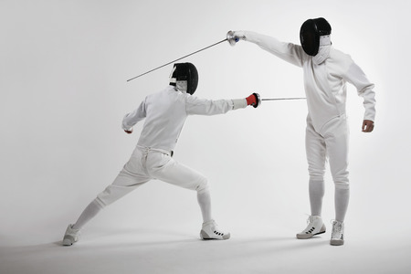 Two men fencing photo