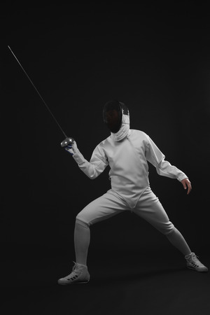 fencing foil: Man holding fencing foil Stock Photo