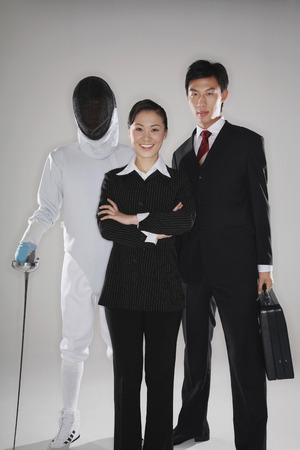 quarter foil: Business people and a man in fencing suit posing for the camera