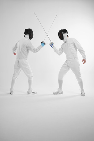 Two men in fencing suits in a duel photo