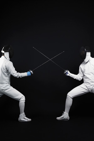 fencing foil: Two men in a duel Stock Photo