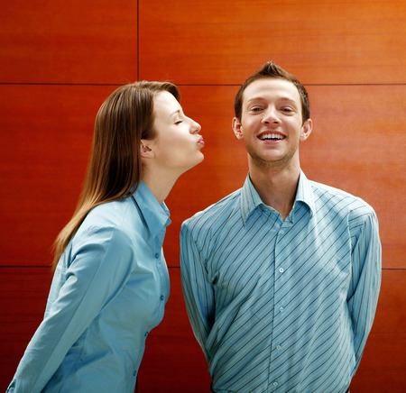 Businesswoman about to kiss businessman photo
