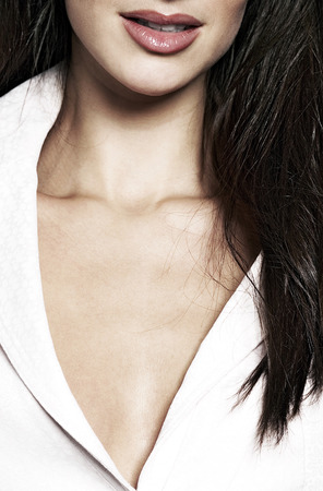 Close-up of a businesswoman in revealing top photo