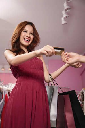 Woman paying with credit card Stock Photo