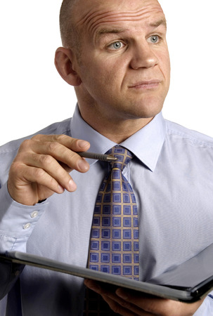 Businessman holding a pen and a document photo