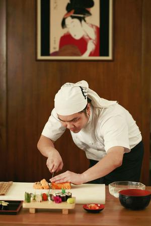 parentage: Chef cutting sushi Stock Photo