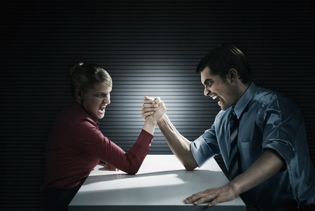 Business people arm wrestling photo