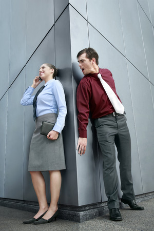 eavesdropping: Businesswoman talking on the phone, businessman eavesdropping