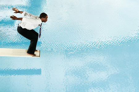 Businessman about to jump off the diving board