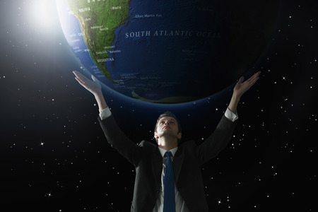 lifting globe: Businessman lifting up a globe