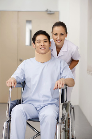 Nurse pushing patient on wheelchair photo