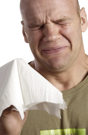 Crying man holding a tissue photo