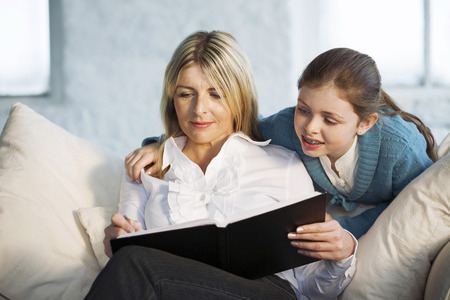 Mother and daughter sharing a book photo