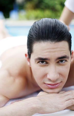 barechested: Close up of a guy by the poolside