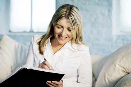 A business lady writing happily