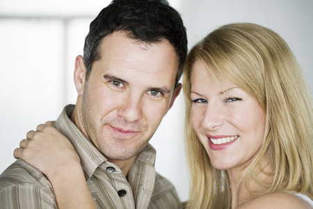 Couple smiling and looking at camera