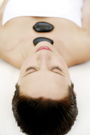 lastone therapy: Woman enjoying lastone therapy Stock Photo