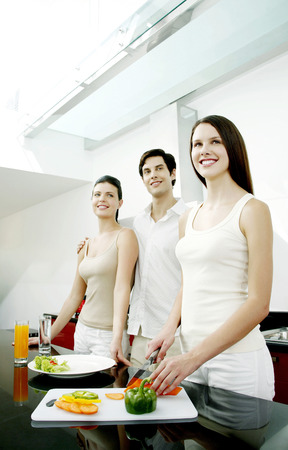 Man and women standing at the kitchen counter photo
