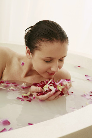 soaking: Woman having flower bath
