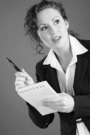 Businesswoman holding a pen and a notepad photo
