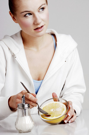 Woman eating orange photo