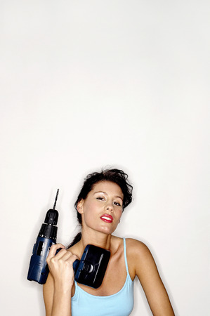 ��role reversal�: Woman holding a drill Stock Photo