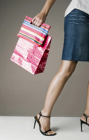 Woman holding paper bags photo