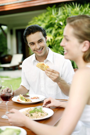 Couple enjoying their meal in the garden photo