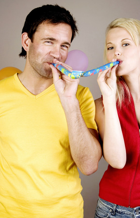 blowout: Couple blowing out blowout Stock Photo
