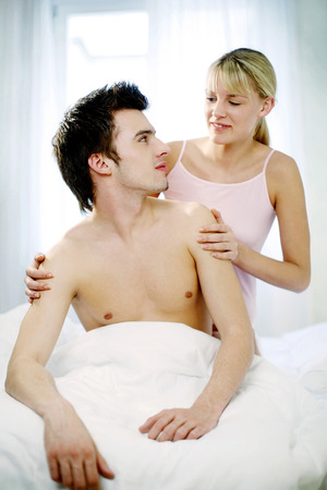 sexual activity: Couple talking in the bedroom Stock Photo