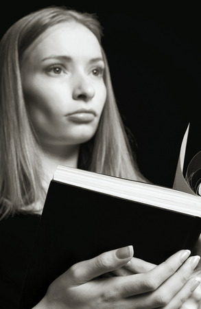 revision book: Woman holding an opened book