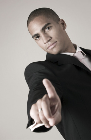 Businessman showing his index finger