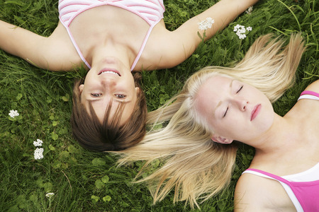 Teenage girls lying on the field photo
