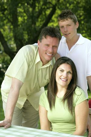 Family posing at the picnic table