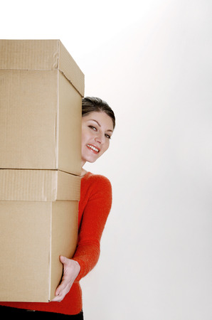 Businesswoman carrying two big boxes photo