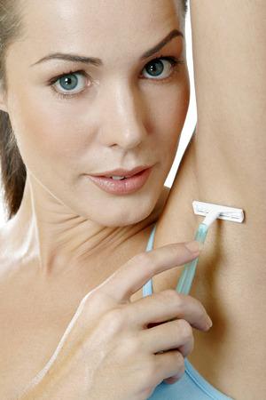 underarm: Woman shaving her underarm